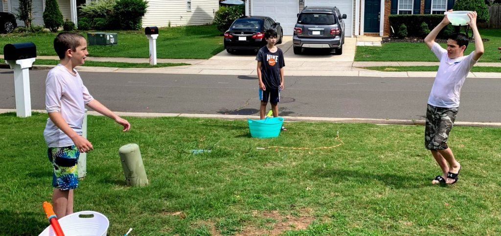 "Create a social distance ""dunking booth"" using water balloon and a kitchen colander."